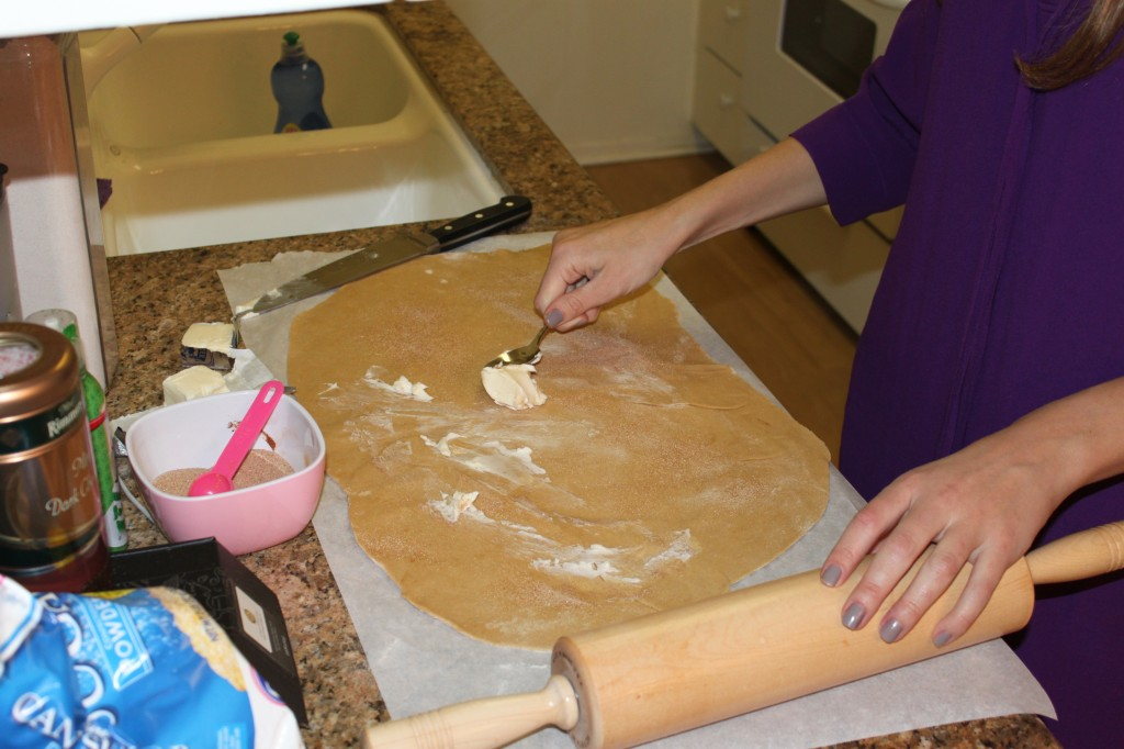 Rolling out Kings Cake dough